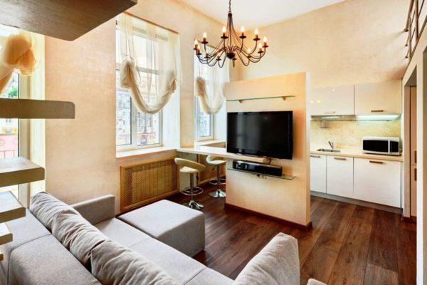 Функциональная стена - один из вариантов отделения кухни в интерьере квартиры студии