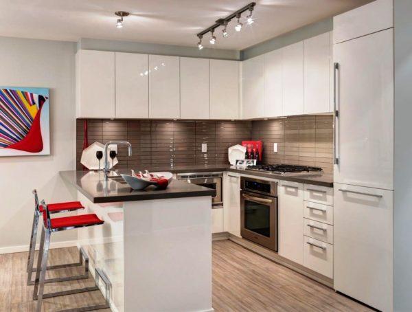 Квартира студия позволяет совместить гостиную и кухню в одном пространстве
