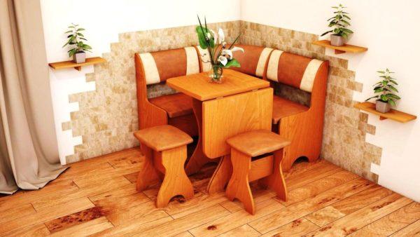 Компактный кухонный уголок с раскладывающимся столиком - очень подходящий вариант для кухни гостиной с малой площадью
