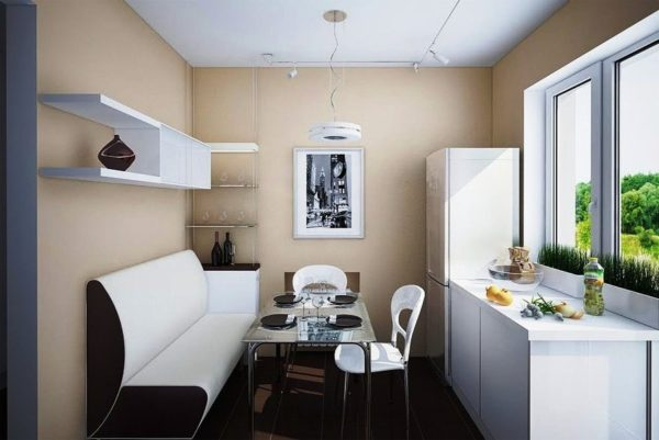 На этом фото диван-кушетка в интерьере маленькой кухни в современном стиле