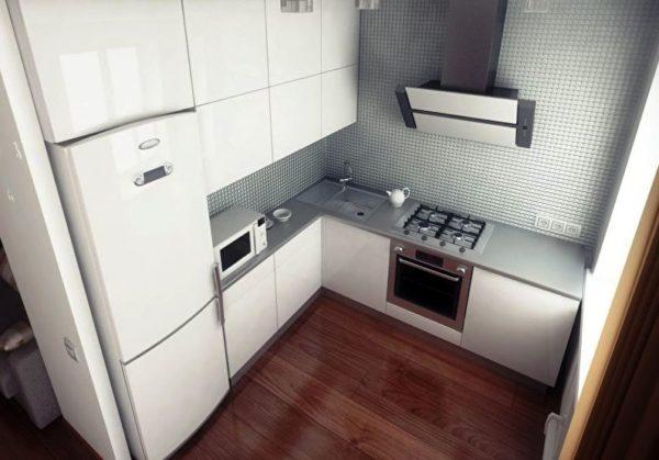 При Г-образном размещении мебели пространство экономится за счет использования двух смежных стен